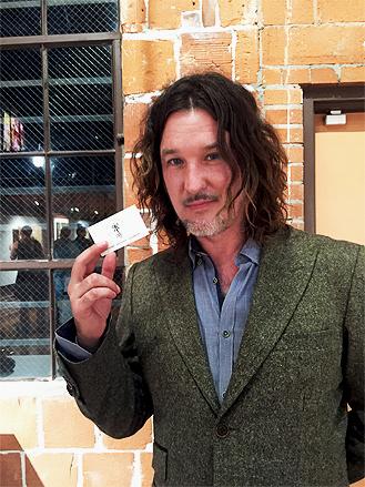 A Happy Longhair With A Card