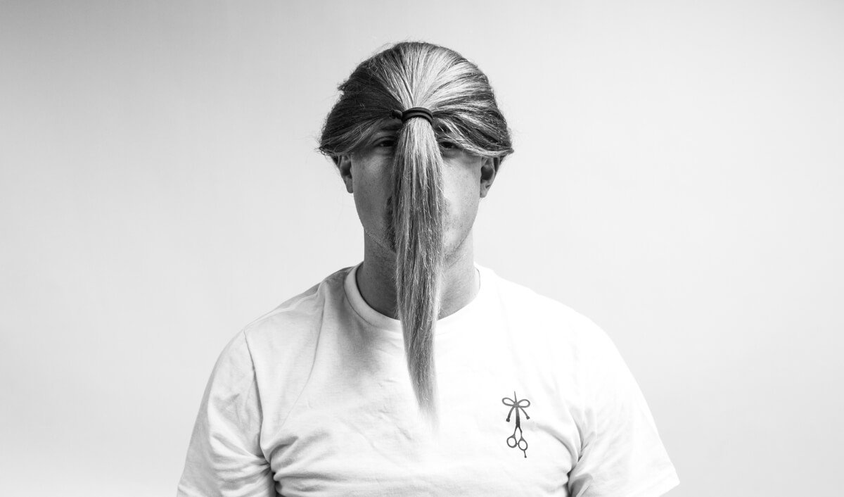 How to Wear Long Hair For Men - The Reverse Menstail (front view)