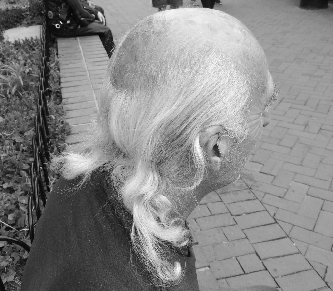 Old man losing his hair with long hair