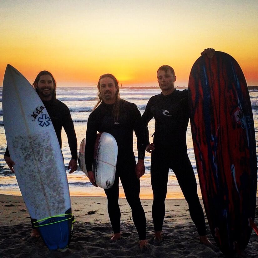 Long hair in athletics: the boys after a sunset surf