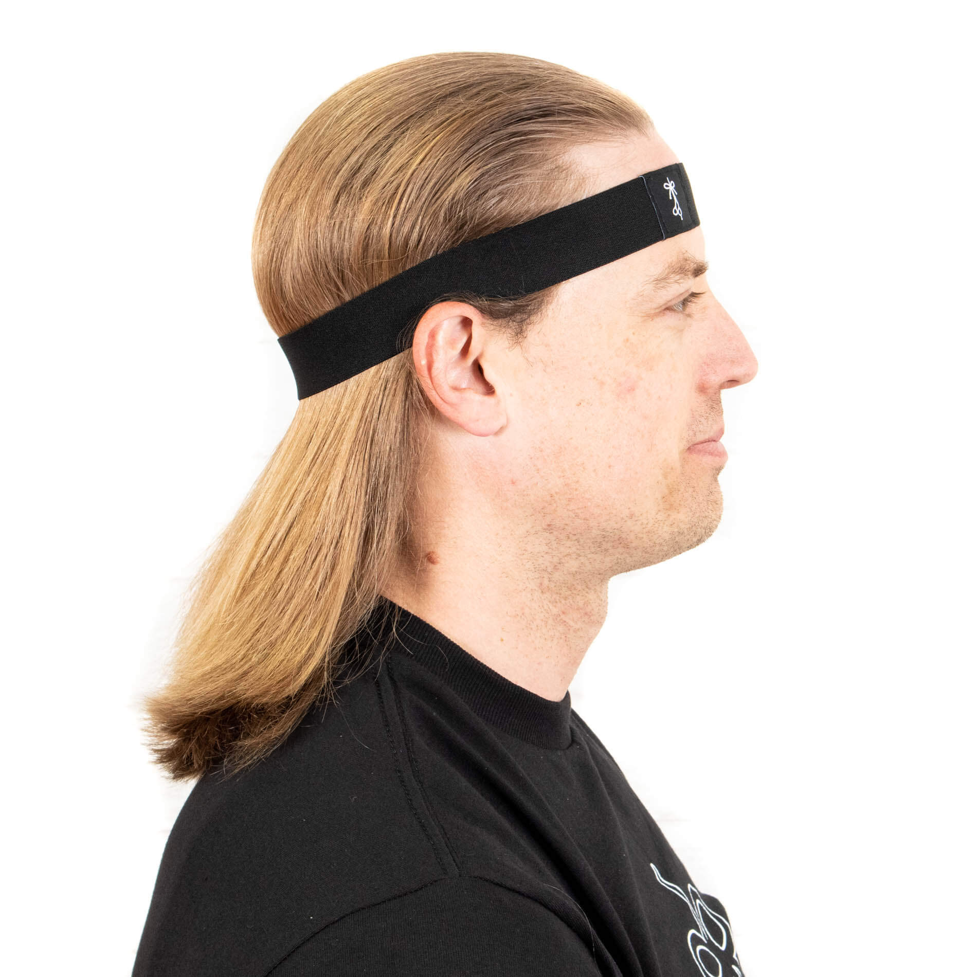 Thick headband holding long hair back behind the ears.