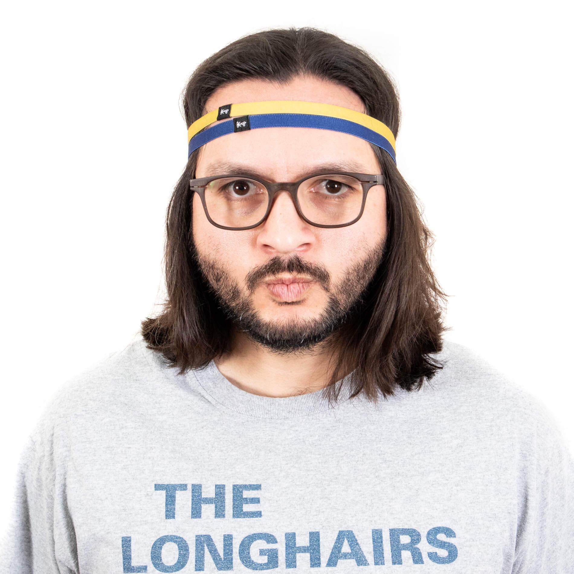 2 thin headbands draped over hair.