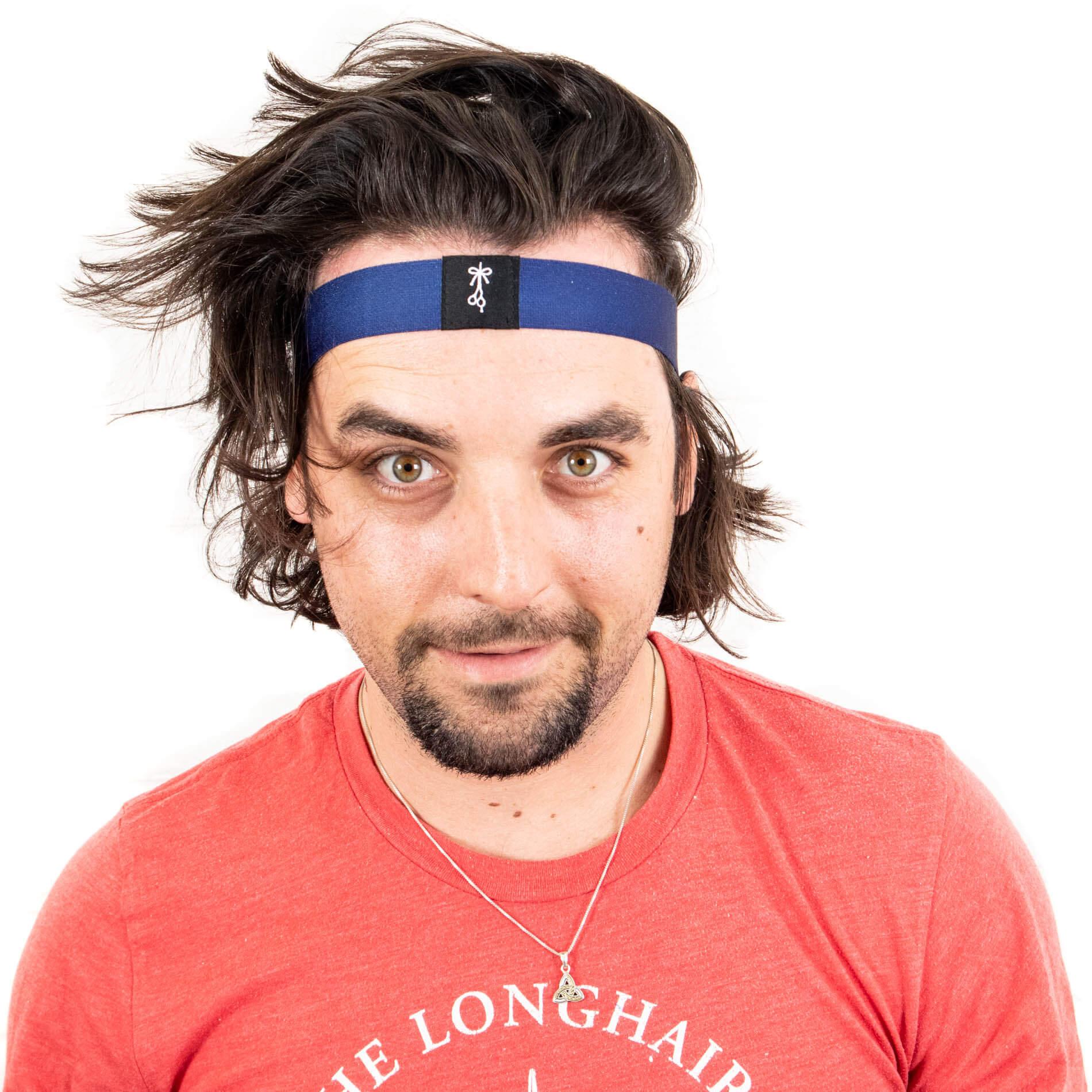 Thick headband worn on forehead like a sweatband.