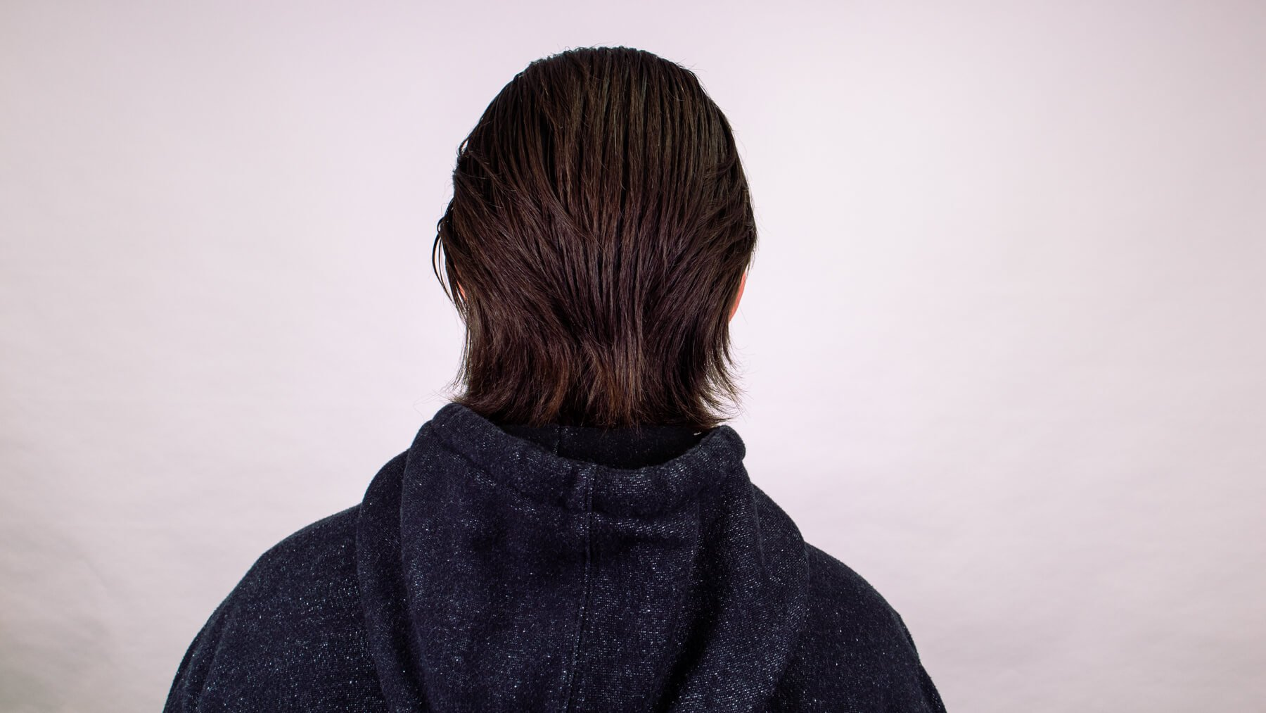 Brushed back awkward stage hairstyle back view