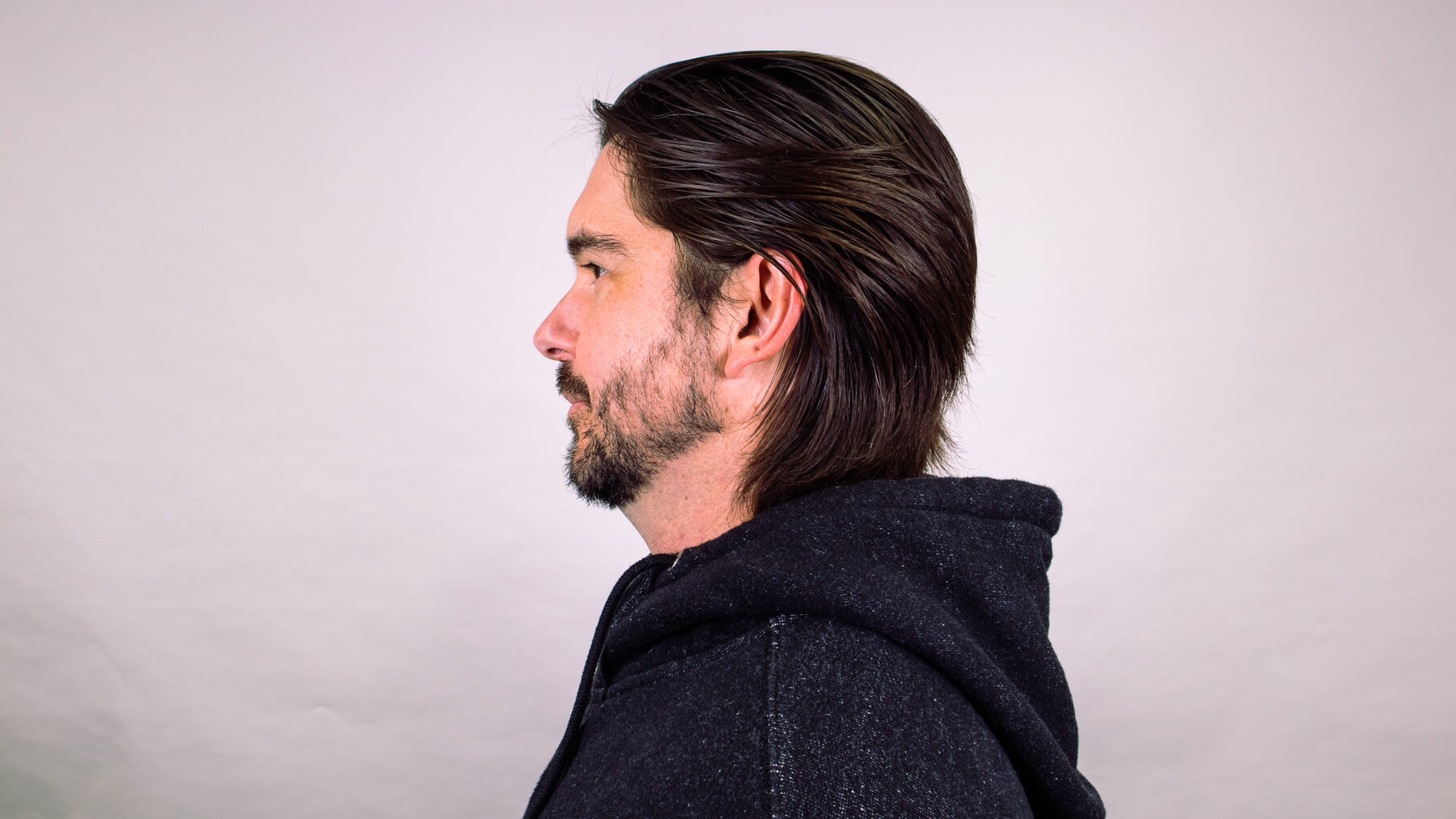 Brushed back awkward stage hairstyle side profile view