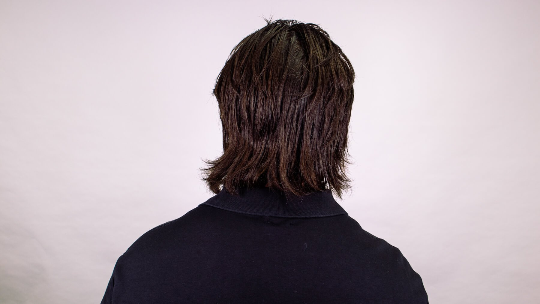 Tousled awkward stage hairstyle back view