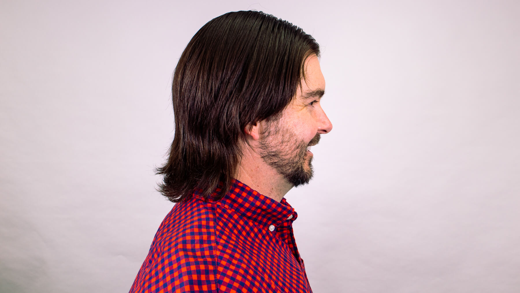 Middle part awkward stage hairstyle side profile view