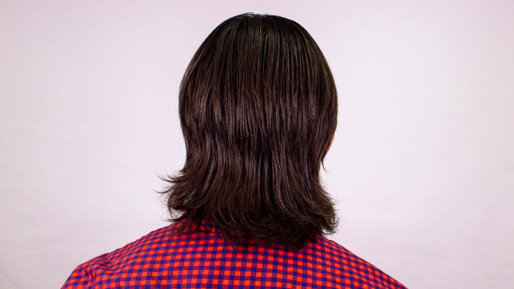 Middle part awkward stage hairstyle back view