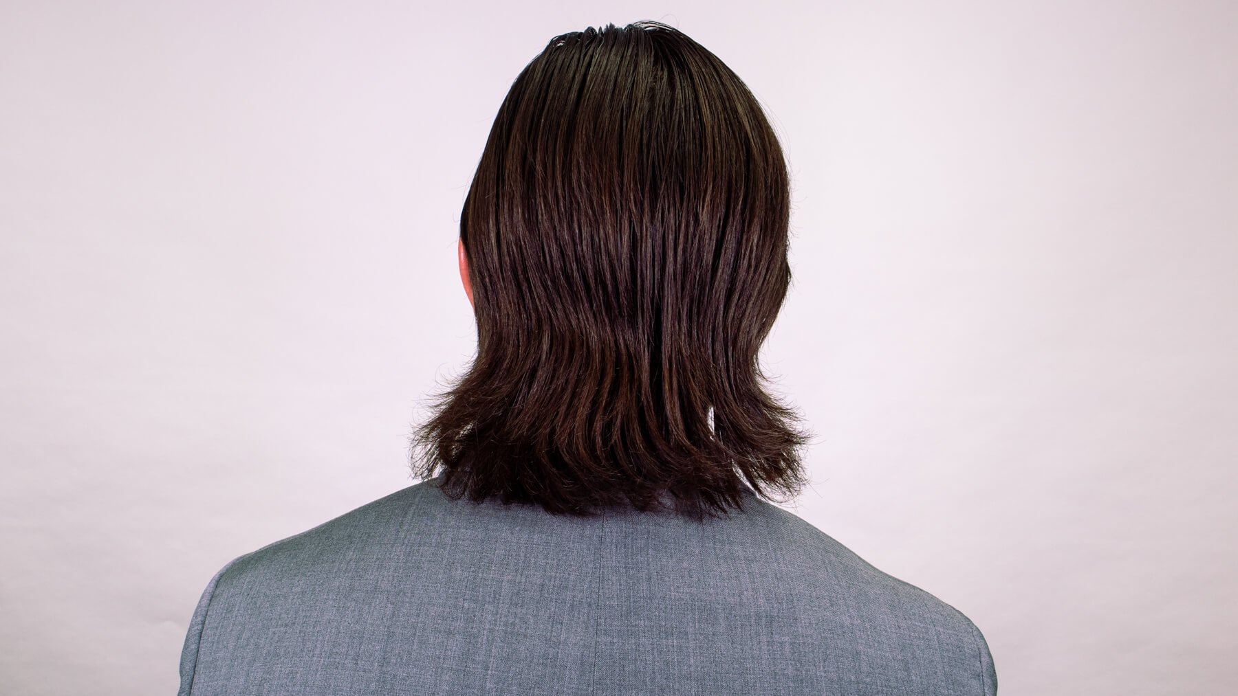 Side part awkward stage hairstyle back view