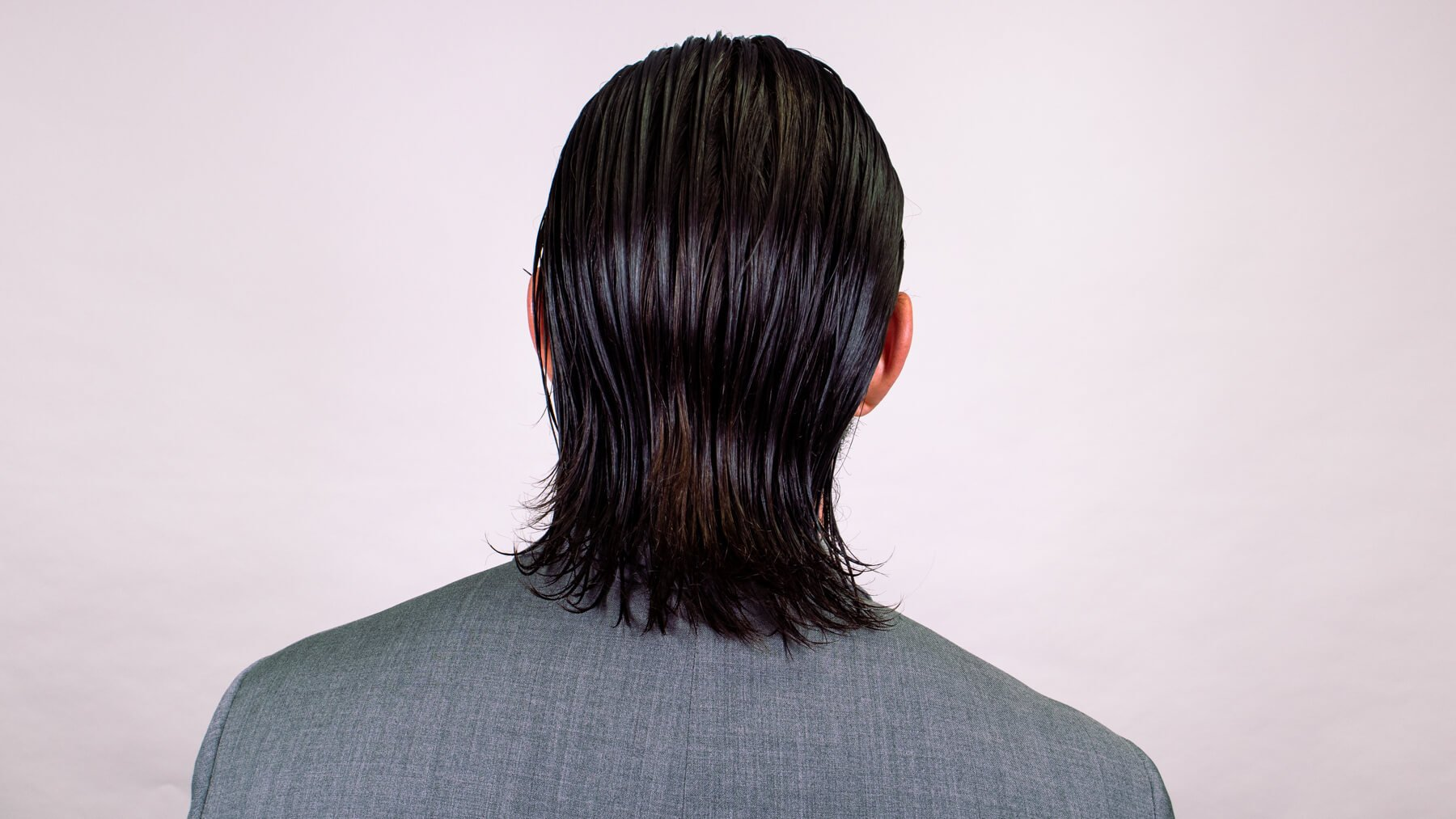 Slick back awkward stage hairstyle back view