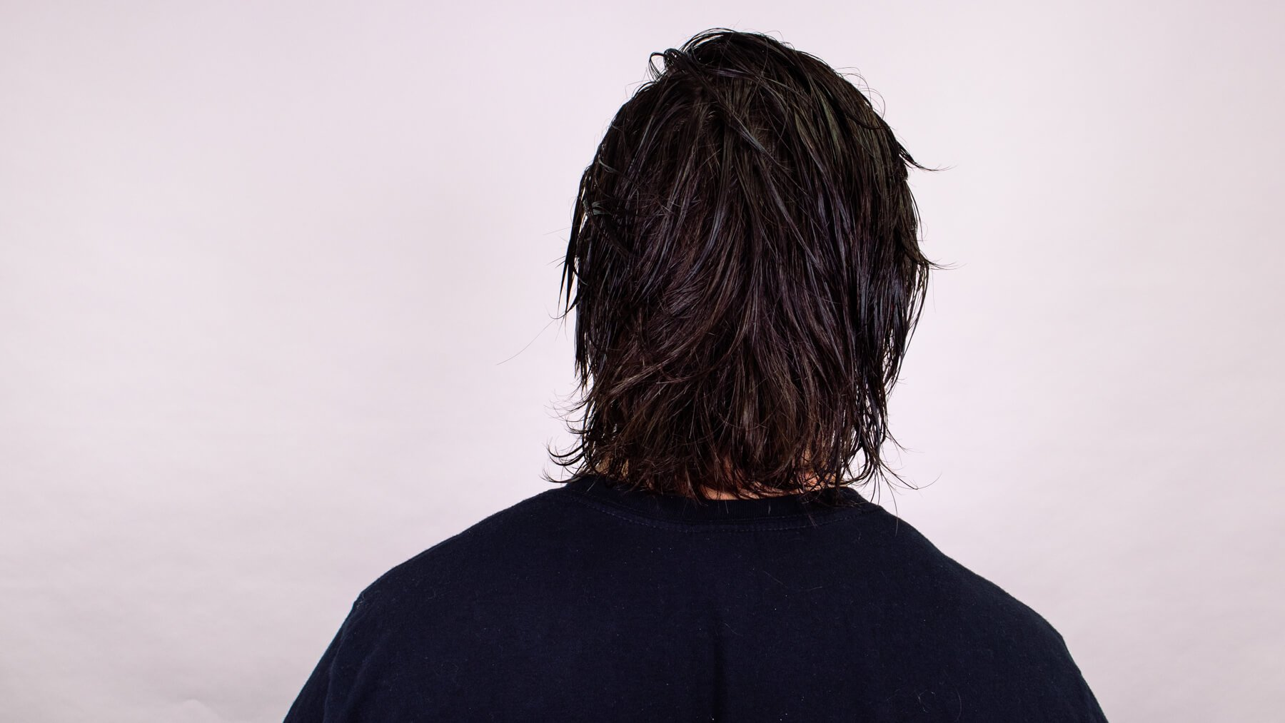 Wet and messy awkward stage hairstyle back view