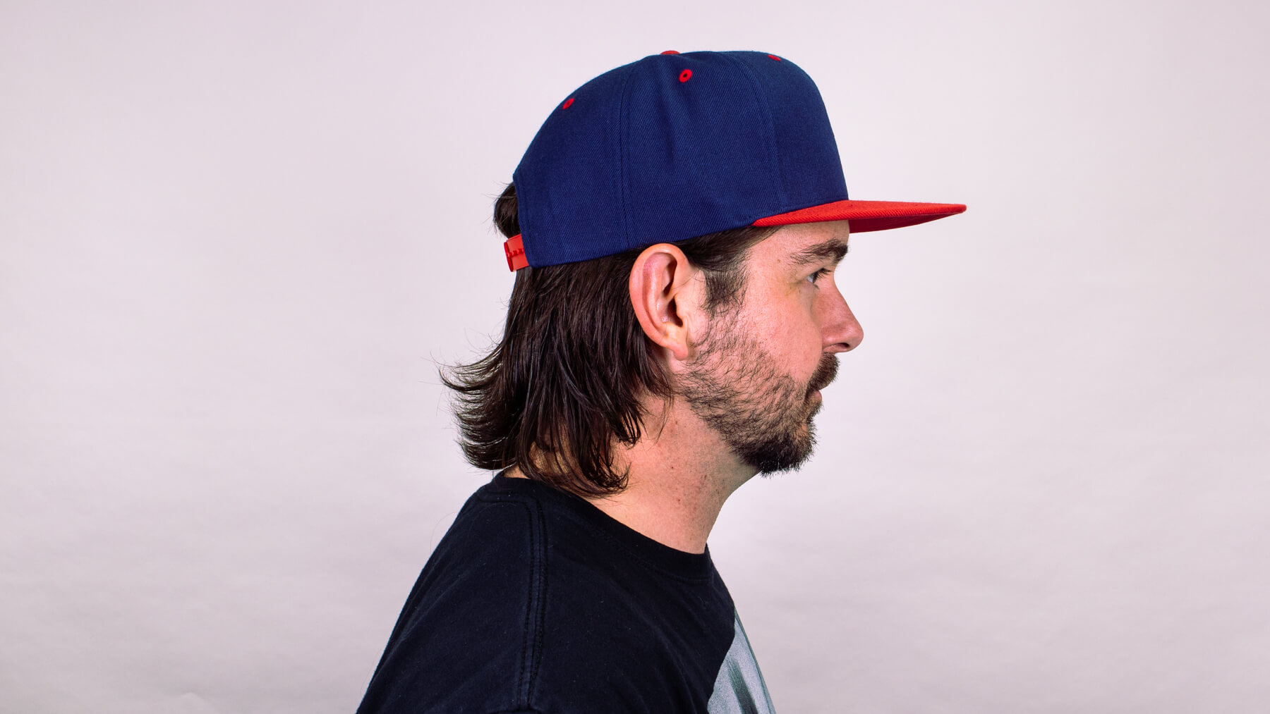 Wearing a hat with awkward stage hairstyle side profile view