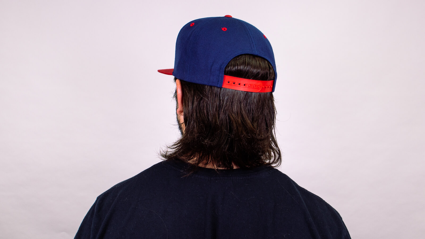 Wearing a hat with awkward stage hairstyle back view
