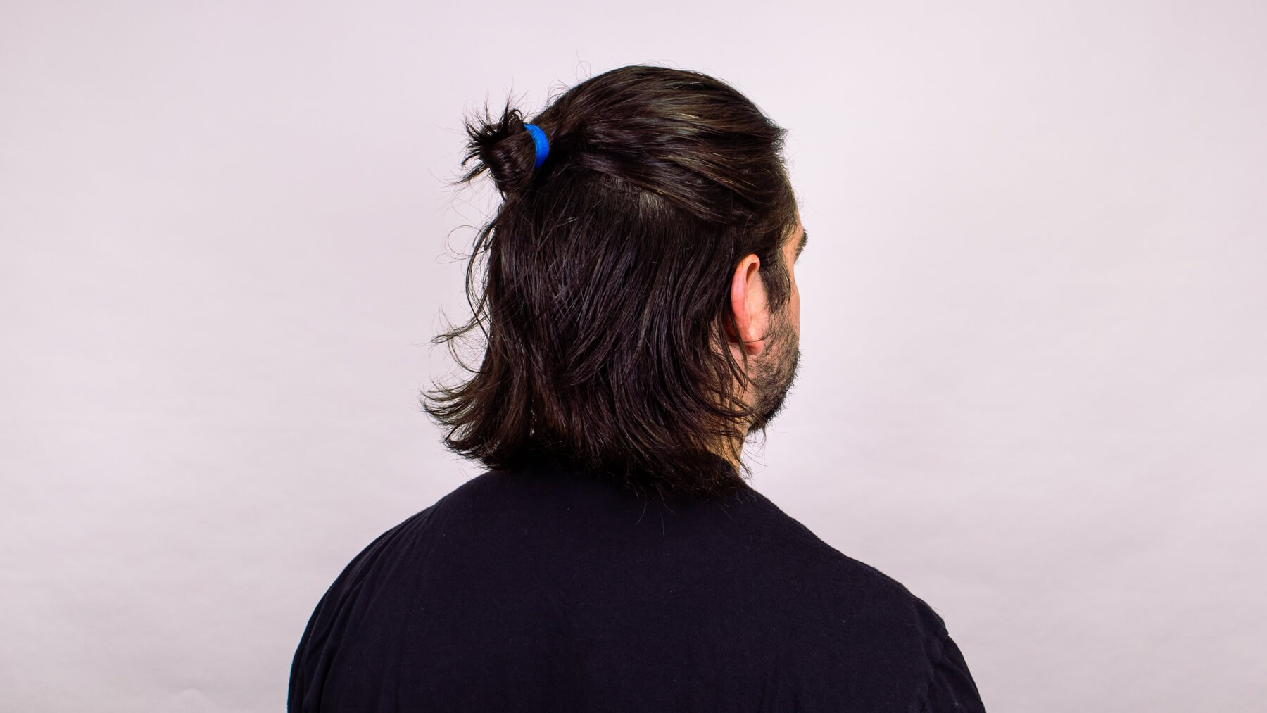 Top knot with awkward stage hairstyle back view