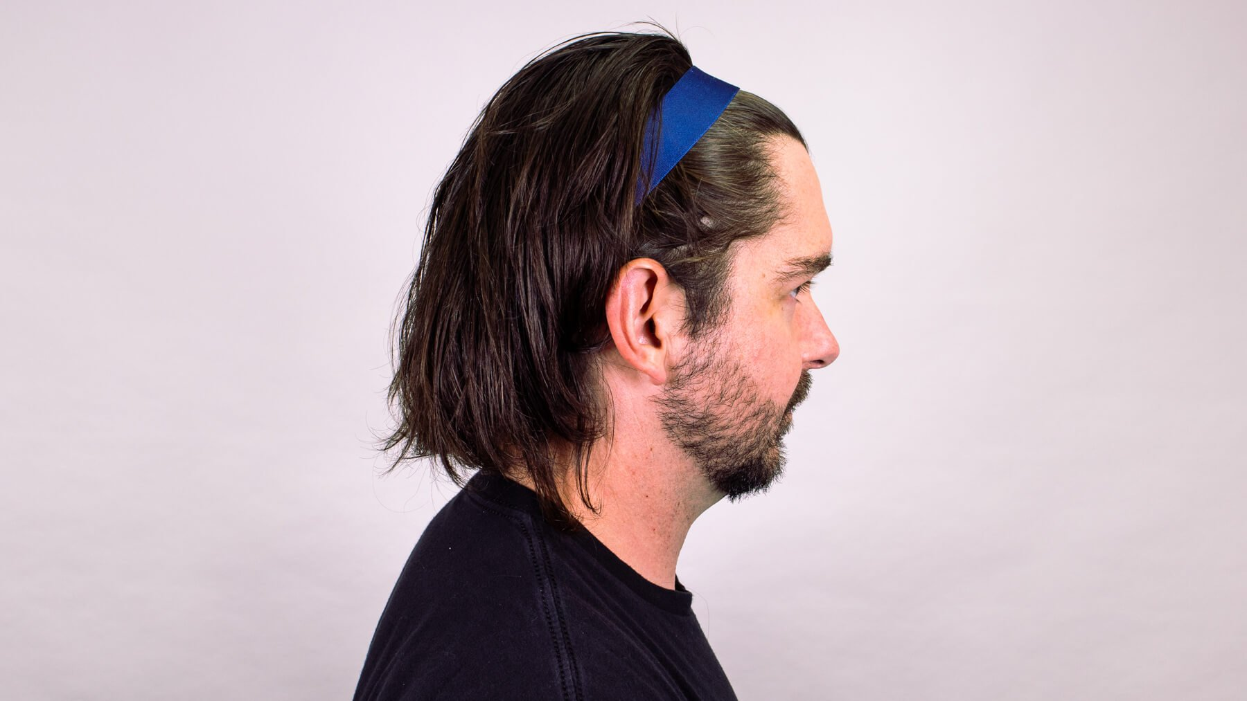 Thin headband with awkward stage hairstyle side profile view