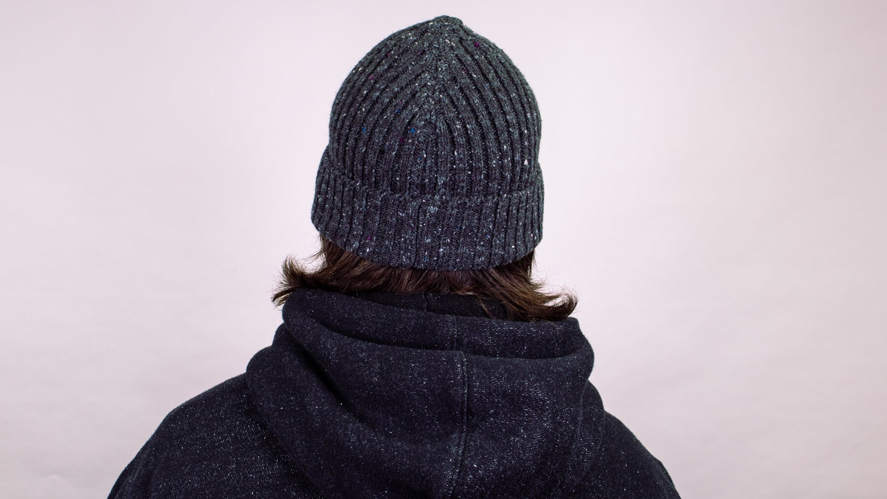 Beanie with awkward stage hairstyle back view