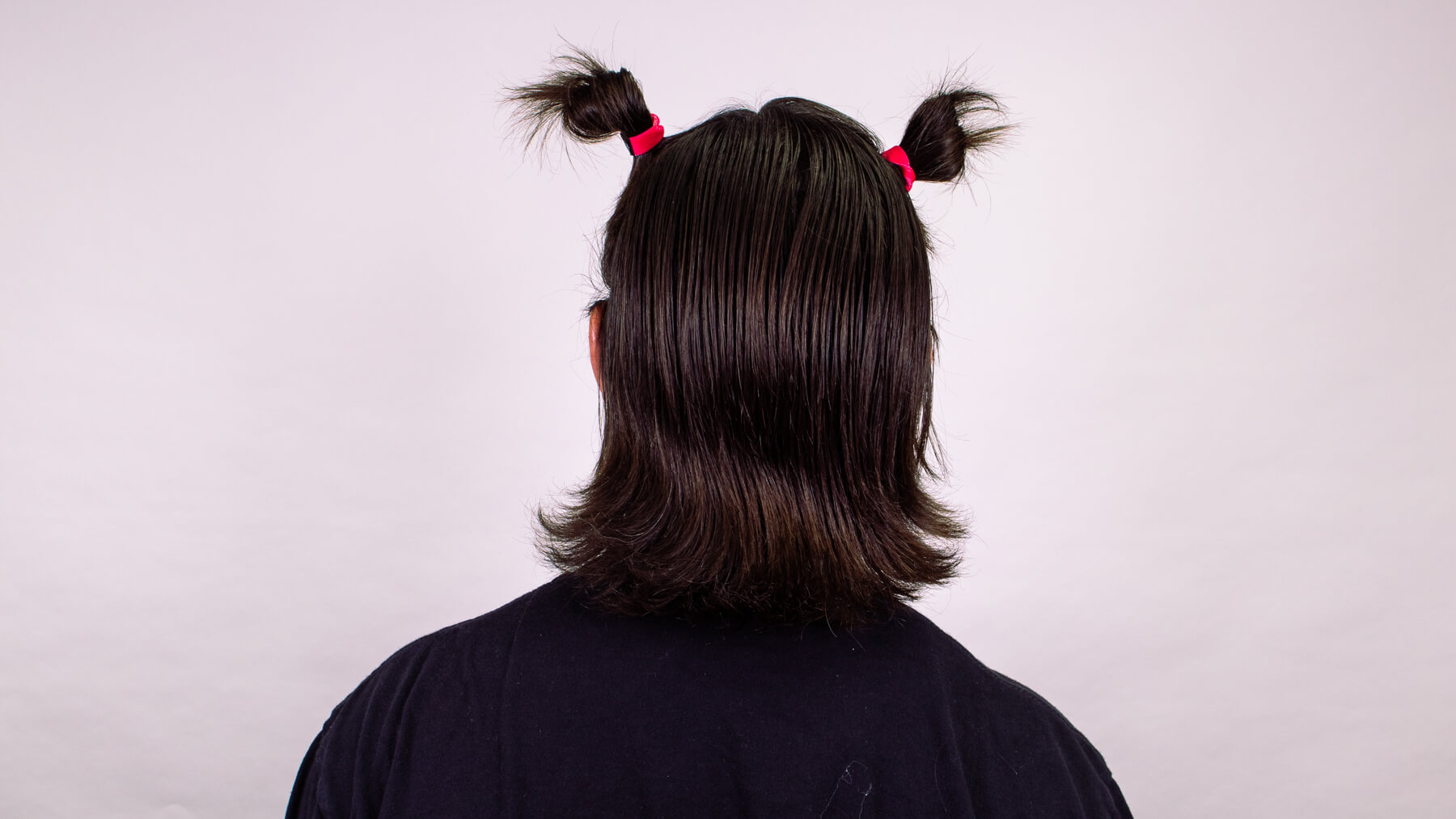 Double bun awkward stage hairstyle back view