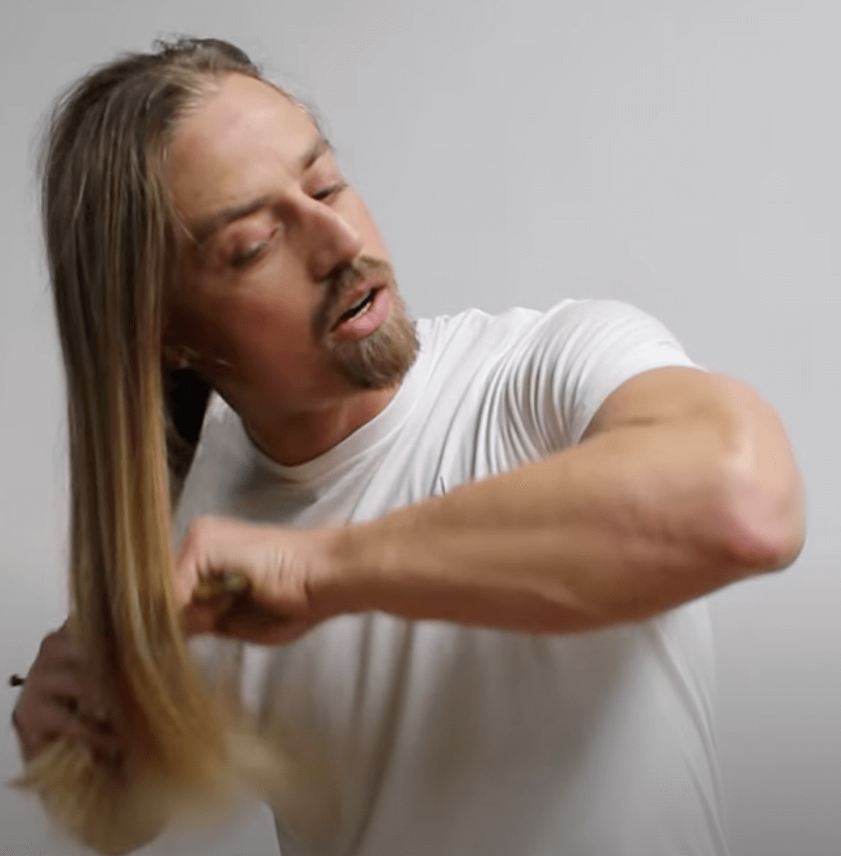 El Rubio demonstrates combing technique in 'How to Brush Your Hair for Men'
