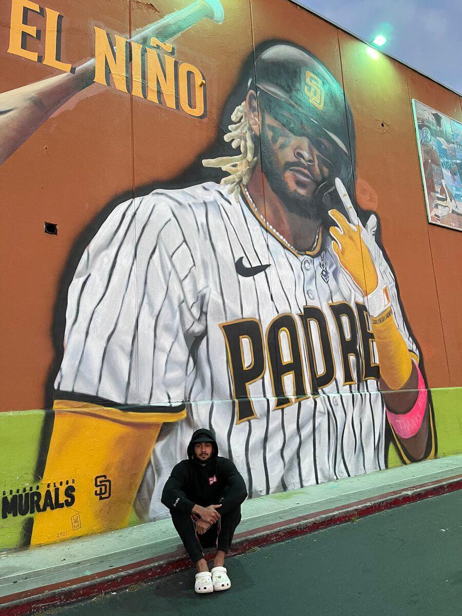 Fernando Sitting Under His Mural
