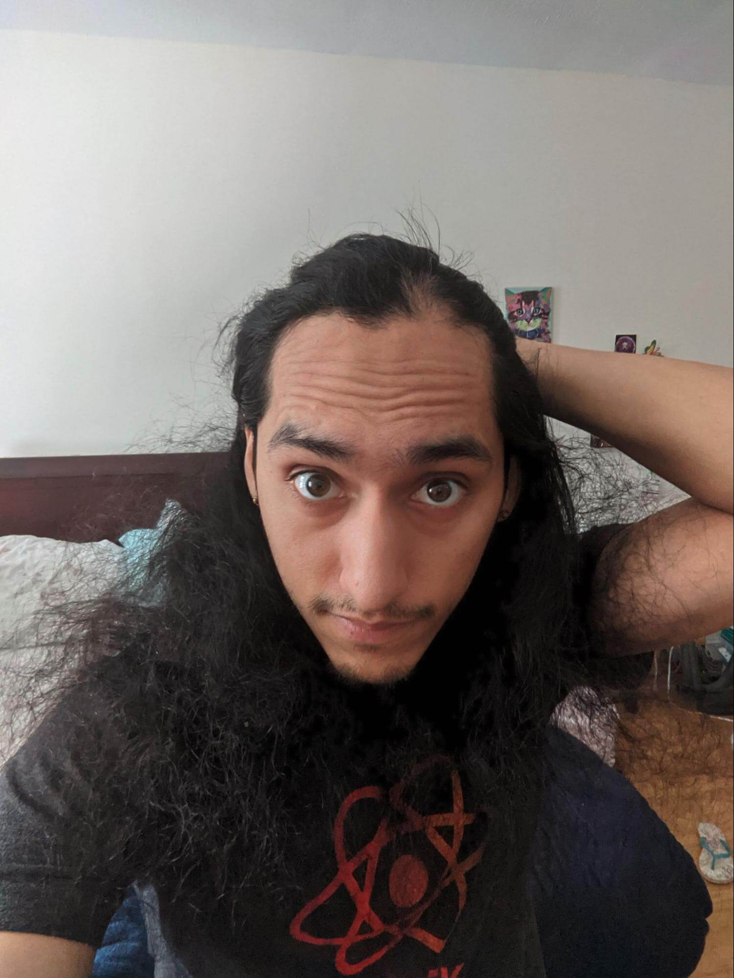 Steven Jimenez looking in the mirror noticing a patch of hair loss from alopecia