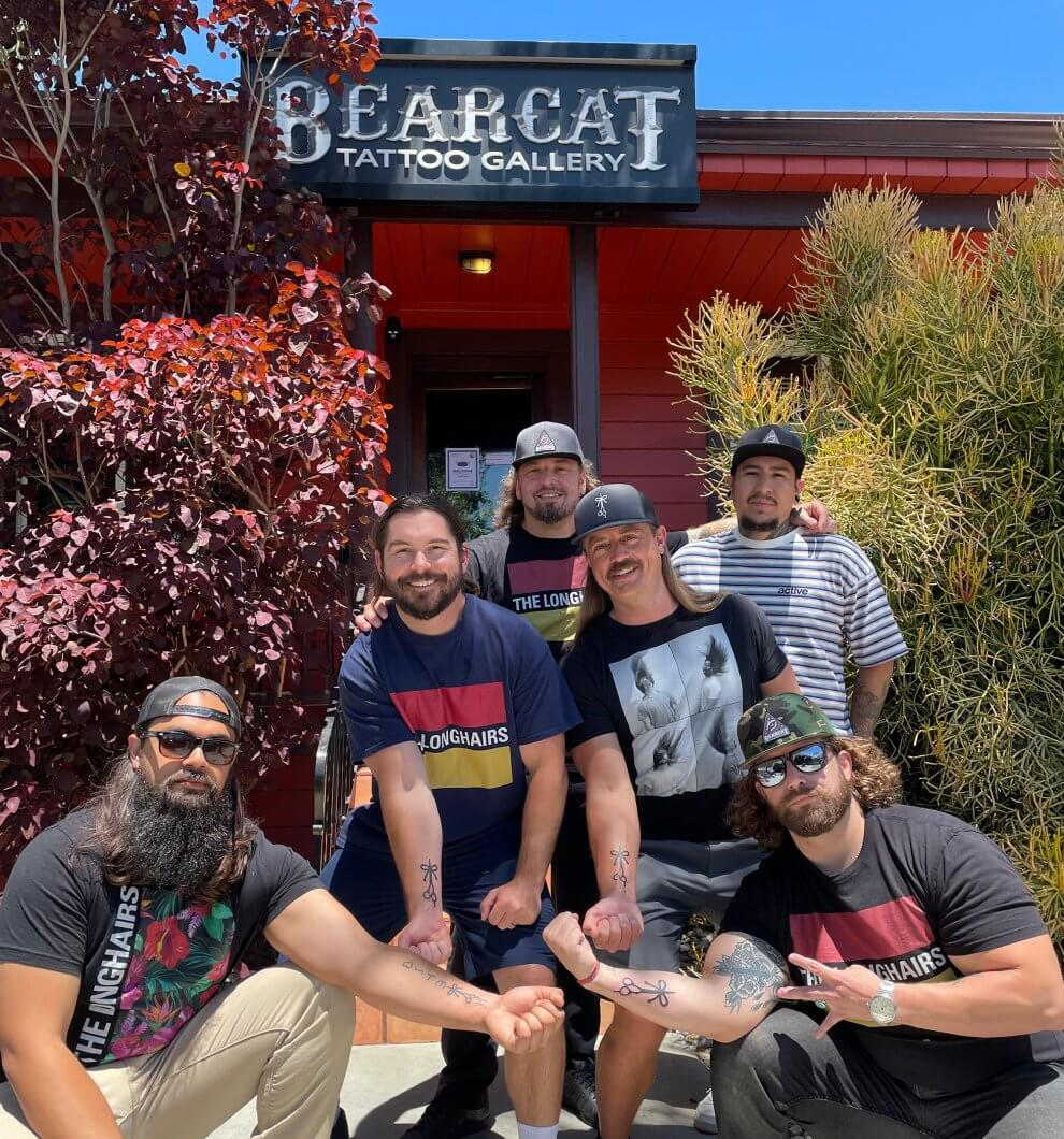 The Longhairs squad shows off their new tattoos in front of Bear Cat Tattoo Gallery Headquarters