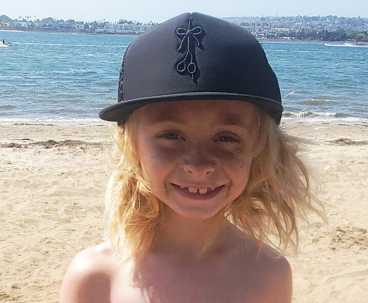 Chase wear The Longhairs SPF hat at the beach