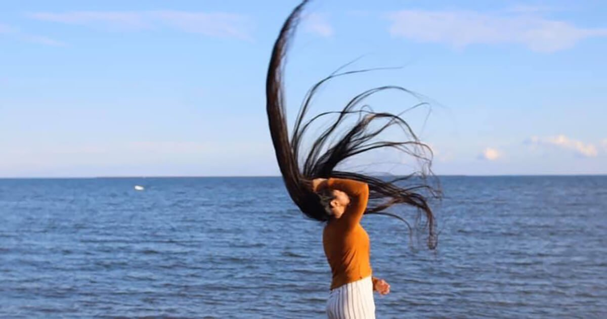 Zahab Khan throwing a legendary six-foot hairwhip in front of the ocean