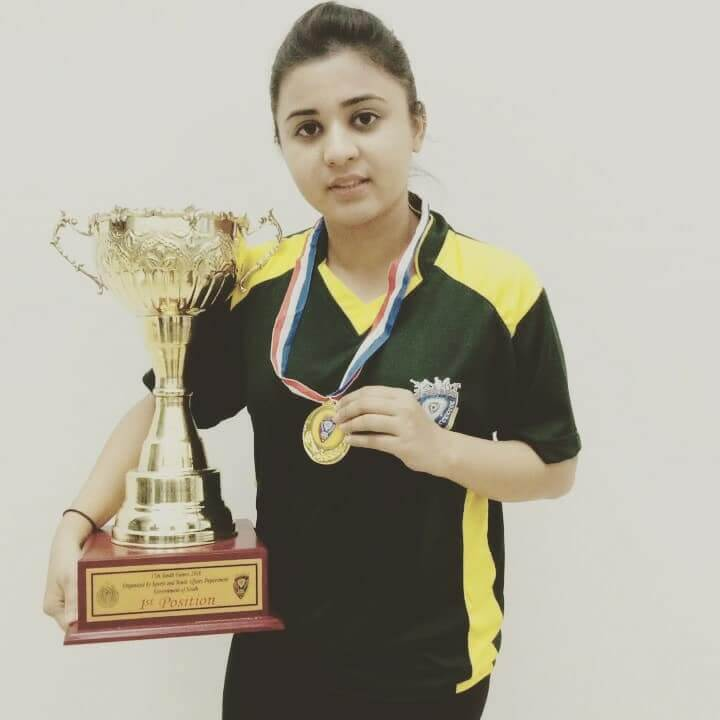 Zahab Khan showing her championship trophy and medal