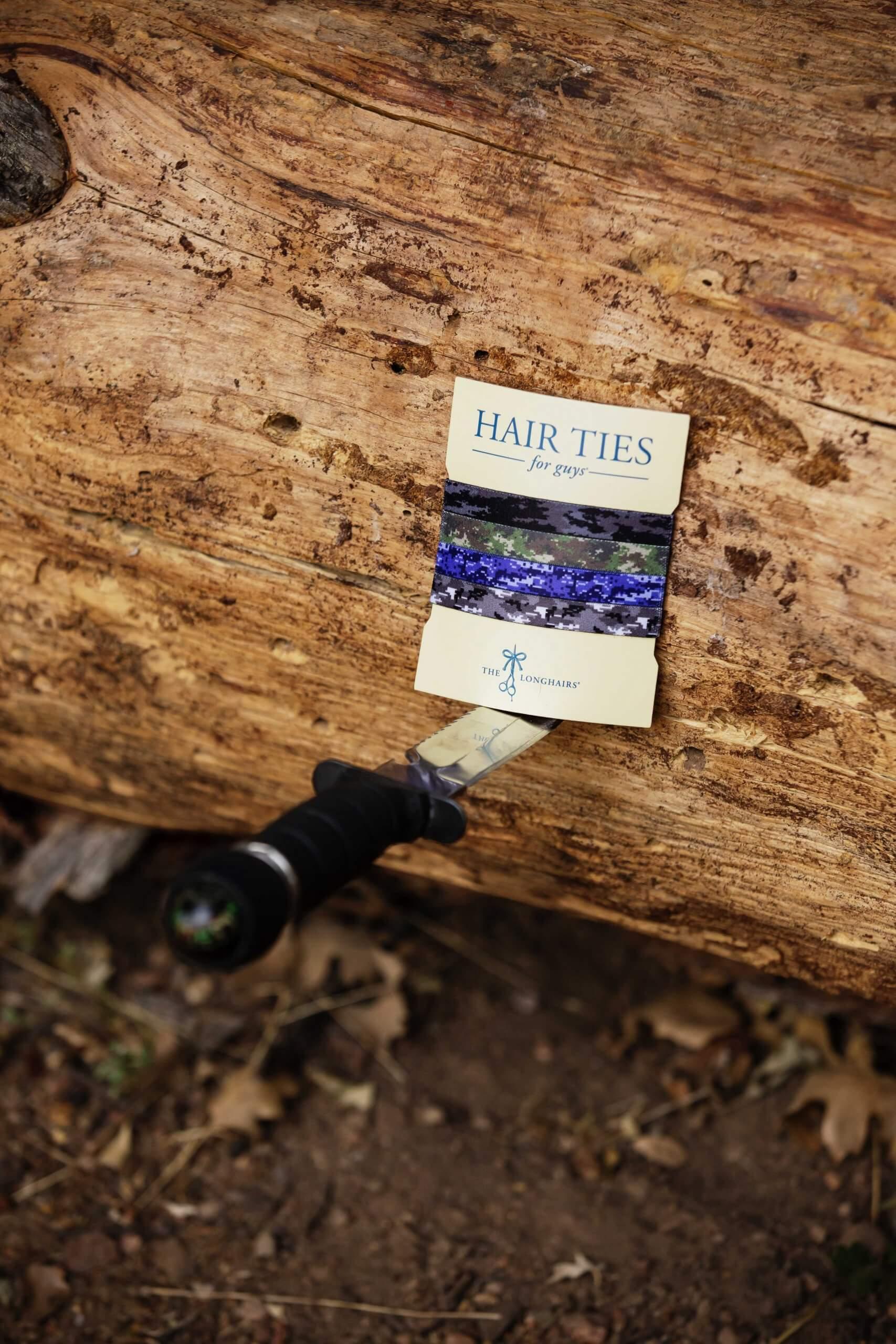 The I Can't See You's being held by a knife in tree at the camping trip photo shoot