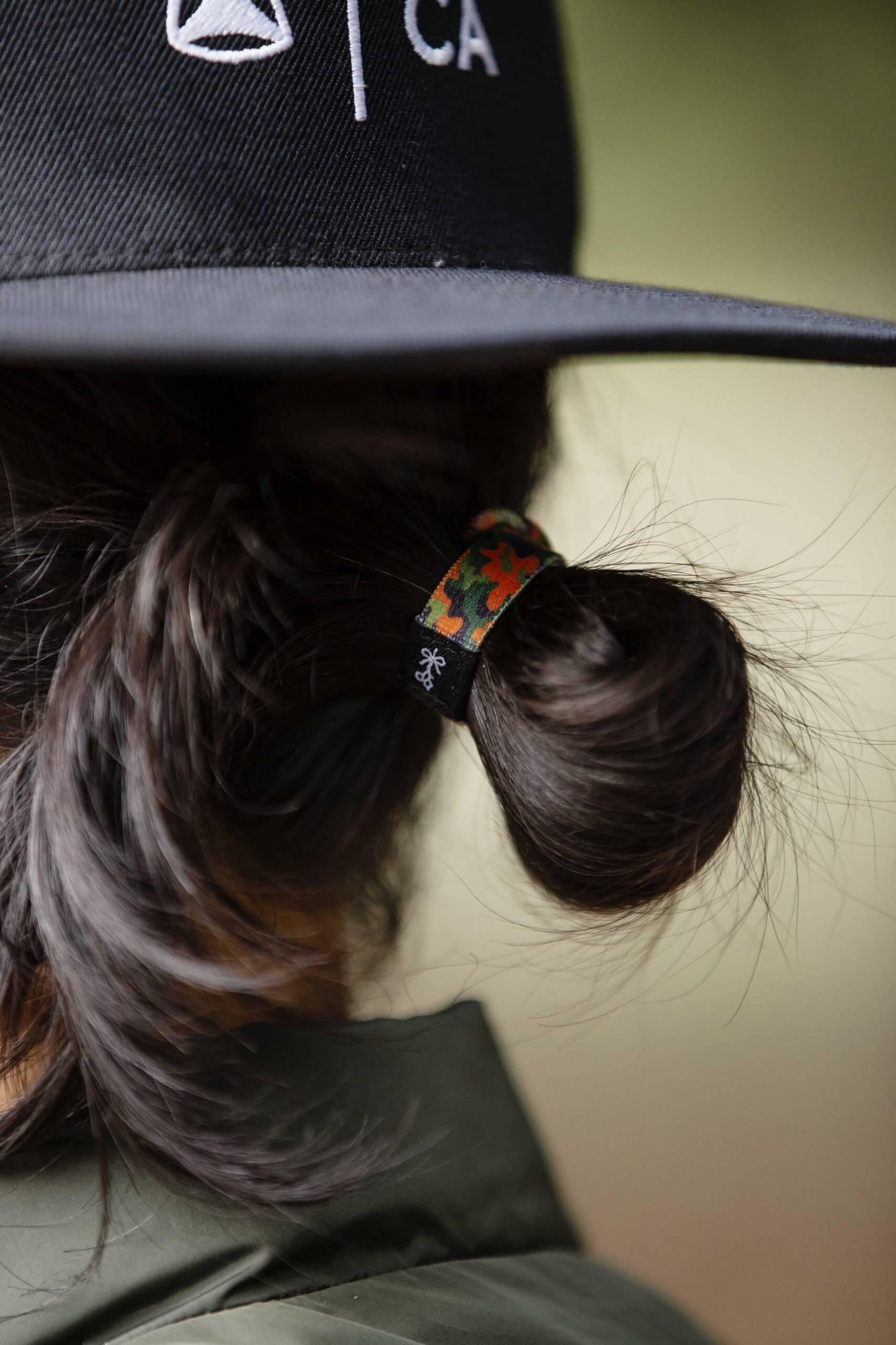 El Garvinski with Hair Ties For Guys in his hair